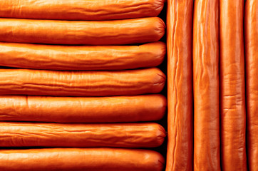 Wall Mural - Close-up of smoked sausages, top view.