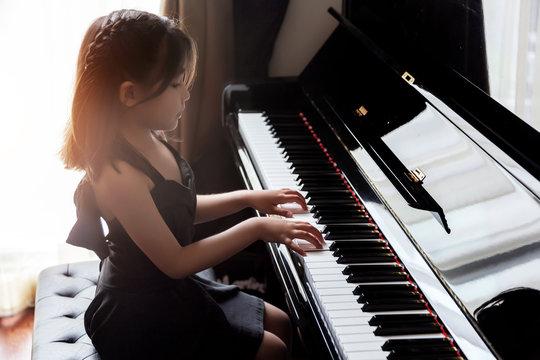 asian girl kids practice play piano