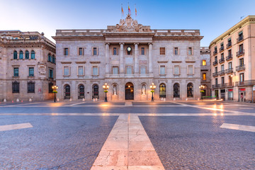 Fototapete - Casa de la Ciutat, City Hall of Barcelona on the Placa de Sant Jaume in The Gothic Quarter of Barcelona during morning blue hour, Spain