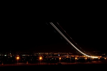 Fotomurales - Airplane Light Trails At Night