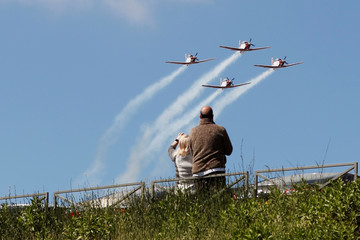 People watch as Israeli Air Force planes fly in formation over Jerusaelm as part of the Israel's 72nd Independence Day events taking place amid coronavirus disease (COVID-19) restrictions around the country