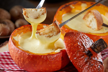 Delicious raclette melted cheese fondue