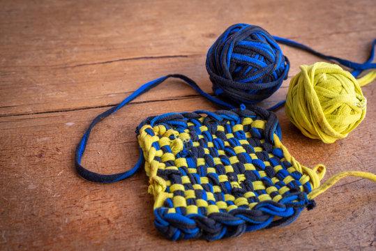 home made Tawashi , Japanese sponge, made with tshirt thread , zero waste kitchen.,yellow  & blue.