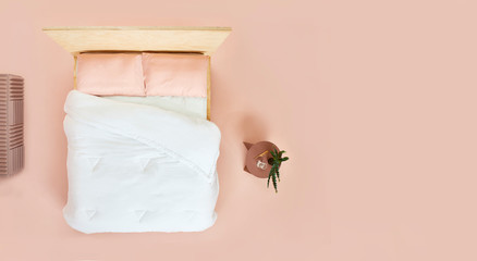 Overhead view of bed in pink room