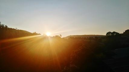 Foto auf Gartenposter Schokobraun Scenic View Of Landscape At Sunset