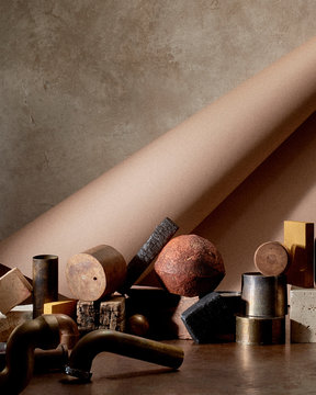 Pieces of metal pipes, wood, and stone in front of paper roll