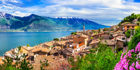 wonderful lake of Italy Lago di Garda. Beautiful panoramic view with Limone sul Garda village and mountains