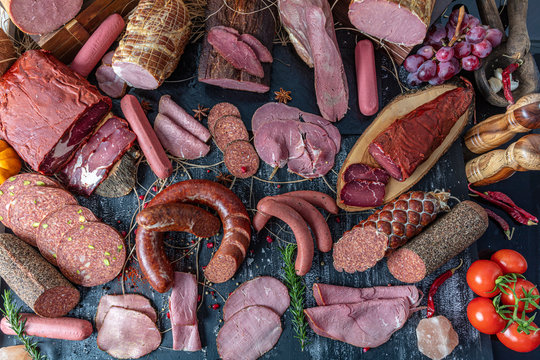 Smoked meat products. Display meats, cold cuts and sausages in a butcher's shop.