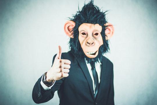 Man Wearing Monkey Mask Against White Background