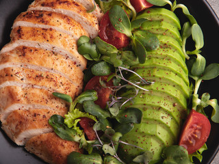 Fototapete - roasted sliced chicken fillet with avocado, tomato, sunflower sprouts healthy