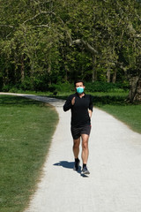 Man running during coronavirus pandemic with face mask
