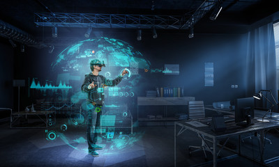 Fototapeta Man wearing virtual reality goggles