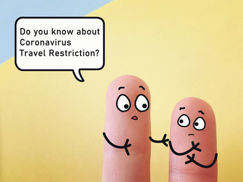 Two fingers are decorated as two person. They are discussing about coronavirus travel restriction.