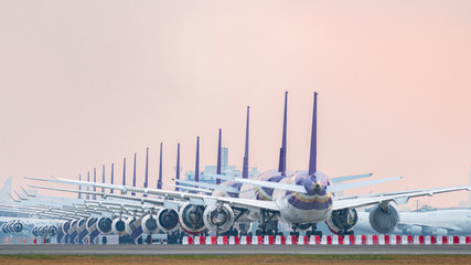 Aircraft parking at airport runway because of COVID-19 pandemic outbreak make airline stop operation. Fotobehang
