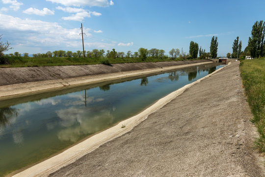 Crimea, Russia, 2014: Rice irrigation canal after fresh water inflow plate from mainland Ukraine. Water Crimea blockade Artificial drought, collapse of agriculture irrigated agriculture