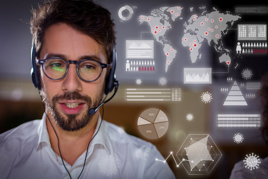 Front view of call center operator talking with interlocutor. Man in eyeglasses looking at screen and talking with virtual global corona virus outbreak diagram. Covid 2019 epidemic concept