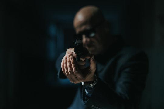 Man Aiming Gun