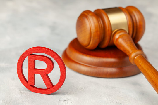 Judge gavel and red trademark sign