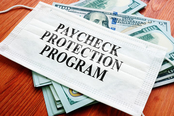 Wall Murals London PPP Paycheck Protection Program as SBA loan written on the mask and money.