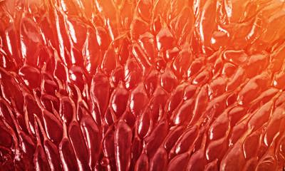 Foto auf Leinwand Makrofotografie Grapefruit slice background. Texture of fresh grapefruit close-up. Abstract macro shoot.