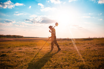 Obraz A man is looking for a treasure with a metal detector - fototapety do salonu
