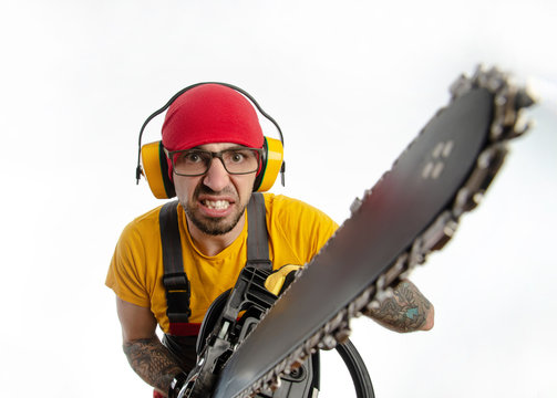 a guy in protective coveralls with a chainsaw on a white background
