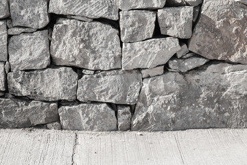 Fototapete - Outer wall made of rough gray stones and concrete