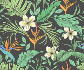 Seamless pattern with tropical flowers and palm leaves