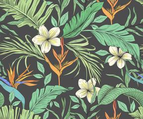 Modèle sans couture avec des fleurs tropicales et des feuilles de palmier