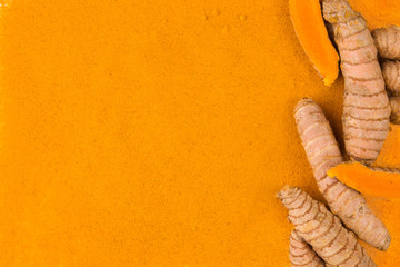Fototapeta Turmeric root powder background. obraz