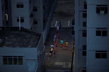 Migrant workers collect their breakfast in their dormitory, amid the coronavirus disease (COVID-19) outbreak in Singapore