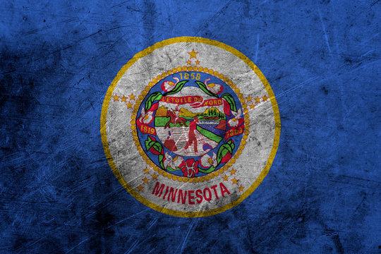 Flag of minnesota, USA, on a grunge metal texture