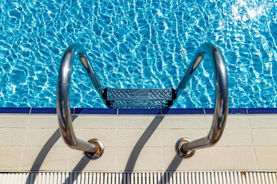 Grab bars ladder in the swimming pool
