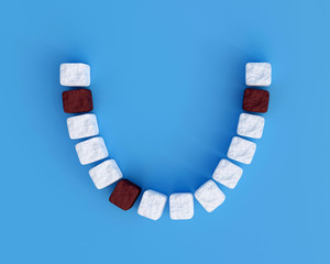 Teeth from sugar cubes on blue background, some brown sugar teeth, concept for sweet tooth, caries. Sugar is the cause of tooth decay. 3d render