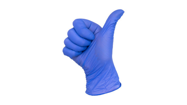 Hand wearing blue nitrile examination glove makes a thumbs up gesture