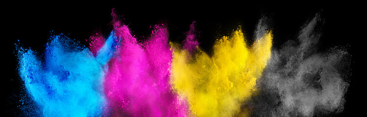 colorful CMYK cyan magenta yellow key holi paint color powder explosion isolated dark black background. printing print business industry manufacturing  beautiful party festival concept