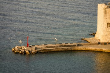 Breakwater in the city of Dubrovnik in the early morning, not yet filled with vacationers and swimmers