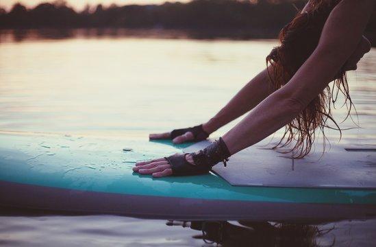Woman On Paddleboard In Sea