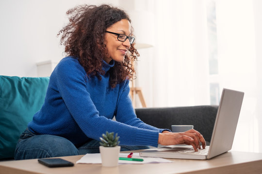 One black woman working from home using laptop