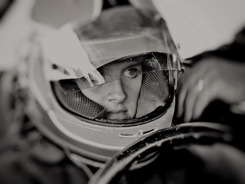 Close-up Of Girl Sitting In Racing Car