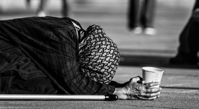 Close-up Of Woman Begging On Street