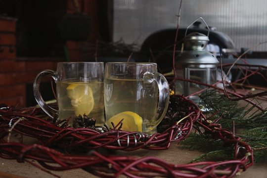 Close Up Of Drinks By Wreath On Table