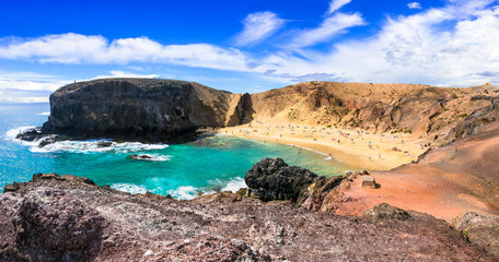 Unique colorful beaches of volcanic Lanzarote. Papagayo beach. Canary islands