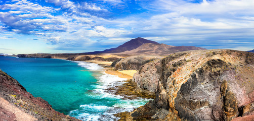 Unique nature and beautiful colorful beaches of volcanic Lanzarote. Papagayo beach. Canary islands
