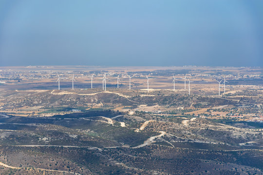 A wind farm is located along a picturesque valley.