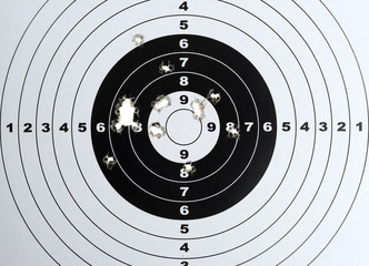 Paper target with pellet gun holes