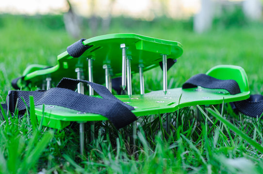 Sole aerator for aeration of lawn soil. Lawn care and treatment.