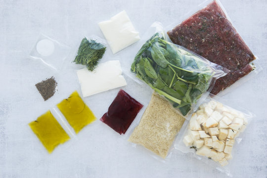 set of products for dinner: minced meat, rice, spinach, celery, dill, olive oil, sauces and spices. Set for delivery of food for dinner on a light background. Cooking at home, home-cooked food.
