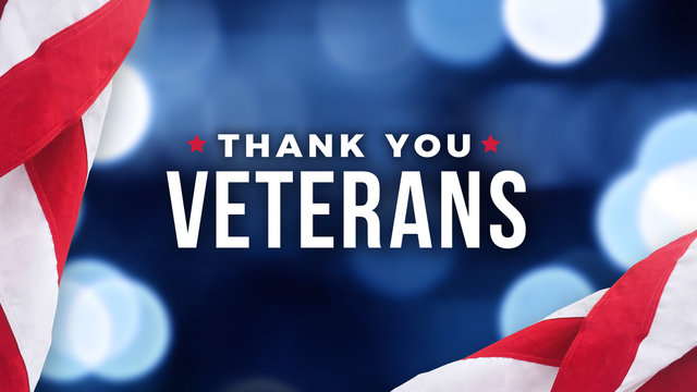 Thank You Veterans Text with American Flag Over Blue Lights Background for Memorial Day and Veterans Day Holidays