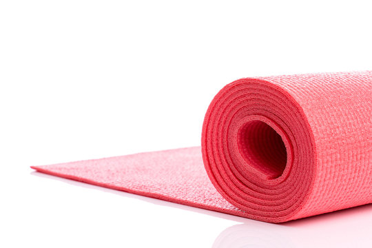 Red yoga mat for exercise isolated on over white background